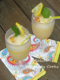 White Sangria Slushie with fresh peaches | www.wineladycooks.com #frozen #drinks #sangria #freshfruit #summer #entertaining @wineladyjo