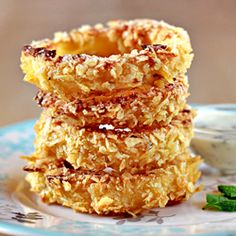 Oven-Fried Onion Rings. Made these: they aren't a blooming onion,but these are crazy good cousin!..probably not any better for u but they do save the hassle of getting out the deep fryer... I baked them like the recipe said and then broiled for just a little at the end to get a nice crispy golden finish..my family devoured them,right down to the crumbs:)