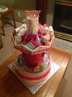 My first attempt at a carousel diaper cake Unique Diaper Cakes, Baby Shower Diapers, Carousel, Babys, Shower Ideas, Balloons, Presents, Nursery, Gift Ideas