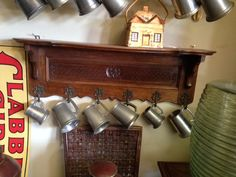 plate rack and pewter mugs: art for kids' rooms: papers great for kids' decor: available for purchase at Uncommon Market Dallas, 100 Riveredge Drive, Dallas, Texas 75207; call us @ 214-871-2775 if you would like to put this item on a 2 day HOLD.