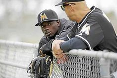 In this Feb. 19, 2016 file photo, Miami Marlins second baseman Dee Gordon leans against a fence during spring training baseball practice in Jupiter, Fla. Reigning NL batting champion Dee Gordon of the Miami Marlins says he unknowingly took the performance-enhancing drug that led to his 80-game suspension.  The startling announcement of the suspension by Major League Baseball came shortly after the Marlins' victory at Los Angeles on Thursday night, April 28, 2016.