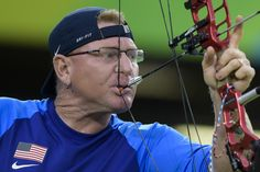 Jeff Fabry of United States of America competes against Dong-Sub Koo of Republic of Korea at the Menâs Archery Individual W1 Qualifying during day 9 of the Rio 2016 Paralympic Games at Sambodromo on September 16, 2016 in Rio de Janeiro, Brazil.