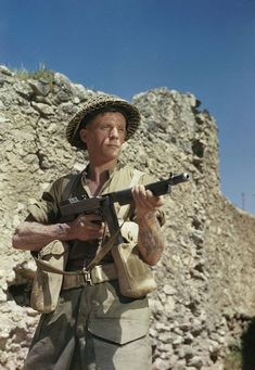 The 'Infantryman'. Corporal M Smith of the Duke of Cornwall's Light Infantry posing with a tommy gun at the main Headquarters of the Eighth Army in the San Angelo area. Corporal Smith a former metal polisher from Birmingham served in North Africa and Egypt before going to Italy in early 1944. He was involved in the fighting north of Cassino and on the Garigliano River.