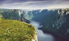 Gros Morne National Park, Newfoundland and Labrador, Canada. UNESCO World Heritage Site, note the people dressed in orange near the center.