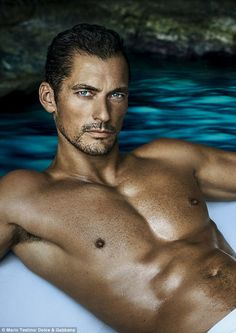 He's back! David Gandy stars in the latest Dolce & Gabbana Light Blue Eau Intense campaign as the new fragrance hits shelves - but admits he had to work 'extra hard' this time