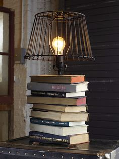 5 ways to repurpose old books- the smartphone dock and the lamp are both great ways to disguise common items in the bedroom