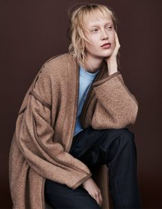 She wears a top and trousers by Hakuï and coat by Sea New York.