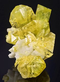 Brilliant, gemmy yellow crystals of Brazilianite with Albite matrix. From Linópolis, Divino das Laranjeiras, Doce valley, Minas Gerais, Brazil. Measures 6.3 cm by 3.6 cm by 3.2 cm in total size.