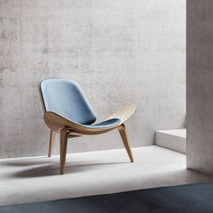 Buy the Shell Chair by Hans J. Wegner for Carl Hansen in the Connox shop. Famous Furniture Designers, Shell, Lounge Chair, Danish Furniture, Furniture Companies, Beautiful Interiors, Living Room Chairs, Chair Design, Home Decor