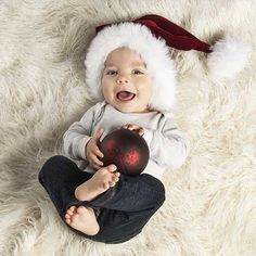 Newborn Christmas Photo Idea. Celebrate your little one's first holiday season with a photography session you'll love to share. Visit jcpportraits.com for more baby photo ideas.