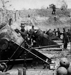 War And Conflict-Civil War Fighting men of 1st CT Heavy Artillery unit standing beside their 13-inch sea-coast mortars, part of heavily fortified battle line during Civil War battle at Yorktown. Location:Yorktown, VA, US Date taken:April 1862