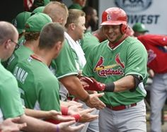 Shortstop Jhonny Peralta is congratulated after hitting a home run against the Miami Marlins during a spring training game.Cards won 7-1. 3-17-15