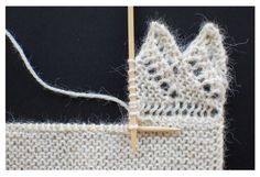 Knitting a lace edging onto live stitches.