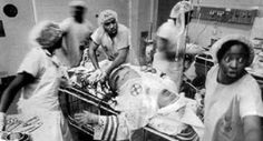 Black doctors treating an injured KKK member.