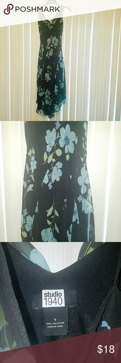 "Studio 1940 Floral Dress Studio 1940 Floral Dress. Black with Blue Flowers and Green Leaves.  Black Slip Underneath. V Neck with Shear light weight flowing material.  50"" Top to Bottom.  Only worn once! Great Condition! Studio 1940 Dresses Midi"