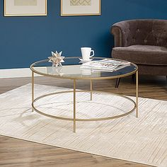 This sleek glass coffee table will make an elegant addition to your living space. The gold trim and a glass surface of this coffee table bring style to any room.