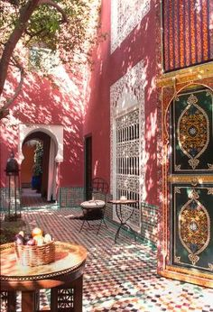 Sun-dappled courtyard at Riad Kaiss in Marrakech, Morocco by Eva0707