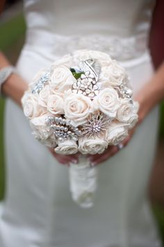 rose and brooch wedding bouquet. We need to renew our vows so I can use all these cute Pinterest things!