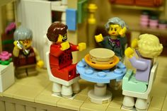 """All that's missing is the lanai. A tribute to """"The Golden Girls"""" wrought in the medium of Lego — including iconic sets and a cheesecake..."""