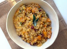 Roasted Butternut Squash and Pancetta Risotto - chicken stock, aroborio rice, butternut squash, pancetta, pumpkin puree, sage, and shallot come together to make this creamy risotto dish.