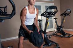 Sandbag workout. Alternate Shouldering builds explosive strength as it forces you to powerfully bring the sandbag from one shoulder to the other. Continue in this motion for long enough and you will be gasping for air in no time. A great cardiovascular workout as well.