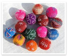 Moroccan embroidered felt beads. I picked up a dozen or so of these balls recently in Morocco. Very cool.