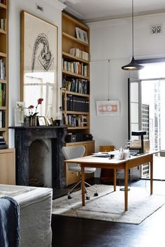 I LOVE this fireplace, shelving and desk setup! Can I have it?!