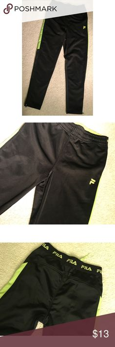e8bf48af0ed7  FILA  Black sweatpants Black and lime green FILA sweatpants. Boys size M (
