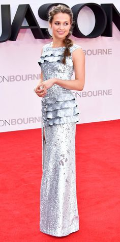 Alicia Vikander has returned to the red carpet in the splashiest fashion. She graced the European premiere of Jason Bourne in an unforgettable silver sequined ruffled Louis Vuitton gown that was at once effortless glam and surprisingly swee Red Wedding Dresses, Prom Dresses, Celebrity Red Carpet, Celebrity Style, Alicia Vikander Style, Paisley Print Dress, Red Carpet Dresses, Red Carpet Looks, Celebs