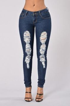- Available in Light and Dark - Mid-Rise - 5 Pocket Design - Skinny Leg - Distressed - 80% Cotton, 15% Polyester, 5% Elastane