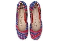 One for One. Mixed woven TOMS ballet flats.