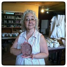 "Y'all know the bowls mugs and now soap dishes that I call ""The Marie Collection""? Meet Marie! I'm a great knitter but can't crochet my way out of a paper sack but this lovely lady sprouts crochet projects like the sun does rays of light (don't let that demure fave fool you she's a pistol!). Here she is holding the soap dish I made for her in her favorite color. Thank you Marie! Love you lady! #ceramics"
