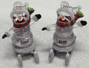 """2"""" Ganz Personalized Sledding Snowmen Christmas Name Ornaments. 342 Different Names Available & 32 Expressions. These are perfect to hang on your christmas tree, or to hang on a small tree in your office, or you can get the Ornament Hanger to display them on. Ganz Sledding Snowmen Ornaments make a great gift!"""