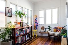 "House Tour: A Colorful Fashion Designer's Crafty Cottage | In Brisbane we have plenty of homes that we call ""post-war cottages."" Built in the '40s, they adapt easily to modern living while still retaining character. The first thing Rachel and Thomas did when moving into their post-war cottage was to paint the walls a neutral color to balance out the colorful collection of decor."