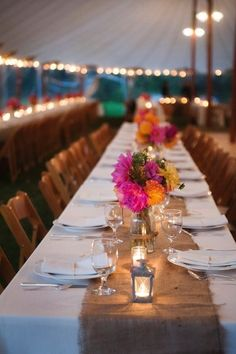 Love this look...burlap table running and vibrant floral centerpieces