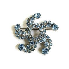 """This is a very pretty Blue Rhinestone Atomic Spiral Brooch #Vintage Cometl!  This pin measures 2 1/4"""" across by 2 1/4"""" high.  Really a beautiful color of blue, and great spi... #vintage #jewelry #fashion #brooches #necklaces #sets"""