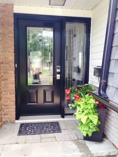 Black front door with one full glass side light