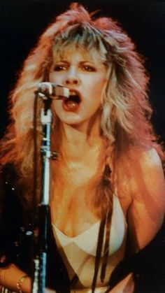 Stevie in a barely there dress and filmy shawl, belting out a song onstage… Buckingham Nicks, Lindsey Buckingham, Members Of Fleetwood Mac, Singer Songwriter, Stephanie Lynn, Stevie Nicks Fleetwood Mac, Women Of Rock, Olivia Newton John, Female Singers