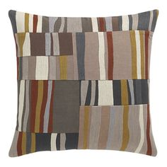 Chainstitch embroidery adds depth and dimension to geometric blocks of rippling color, pieced together in a modern palette of neutrals, orange, gold and cream. Square pillow reverses to solid grey (see additional photos).