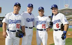 Former Dodgers infielders, from left, Ron Cey, Bill Russell, Davey Lopes and Steve Garvey pose for a photo.
