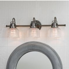 Fresnel Glass Restoration Bath Light - 3 Light 2 finishes! A design grounded in aesthetic authenticity, with double prismatic fresnel glass on finely crafted gooseneck and knob metal detailing. A restoration styled bath light perfect for traditional or modern interiors