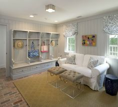 Mud room with brick floor, gray beadboard built-in open lockers, Ikea Hovas Sofa, lucite trunks with rope handles, cobalt blue garden stool, Visual Comfort Lighting Basil Flush Mount and brick floor. * an actual mud ROOM-hr