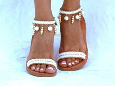 Handmade leather sandals made to order. Bride sandals, White Beach Wedding Sandals, Pearls sandals, Greek Sandal, barefoot sandal, Genuine leather shoes, Summer shoes This leather sandals are made with white ribbon and pearls, Perfect for beach wedding! Handmade from 100% Real strong Leather, Greek Sandals! This summer is yours! Be unique with this gorgeous authentic Delos leather sandal. *You can wear this sandal all day. *We can make this in any size *Rubber sole for comfortable…