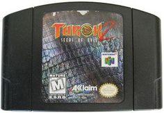 Turok 2 Seeds of Evil (Black) - Game Dinosaur Hunter, Nintendo 64 Games, Original Nintendo, First Person Shooter, Big Guns, School Games, Game Sales, Blow Your Mind, Great Videos