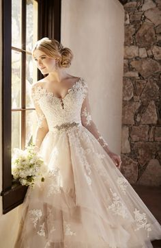 (sp) This elegantly crafted designer tulle wedding dress from Essense of…