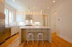 White kitchen with focus on natural wood floors. Love the clear glass pendants! I'On Residence - traditional - kitchen - charleston - by Melissa Lenox Design Kitchen Interior, Kitchen Decor, Design Kitchen, Light Kitchen Cabinets, Kitchen Island, Kitchen Faucets, White Kitchen Inspiration, Cabinet Inspiration, Taupe Kitchen