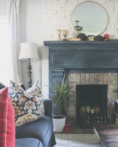 Beautiful fireplace mantle project by The Holliday Collective | Distressed Chalk Paint® by Annie Sloan in Graphite