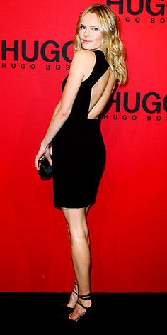 Kate Bosworth is simply chic in a minimalist black sheath, ankle-strap pumps and a small clutch for the Hugo Boss fashion show in Berlin.
