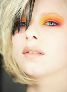 A little bit of orange eyeshadow can really make complimentary blue eyes pop.
