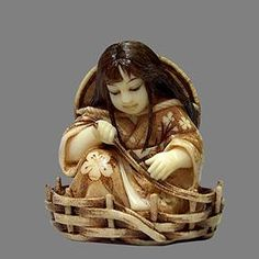 It was carved from walrus tusk. The size is 4.8 cm. The hair and make-up were done with Rose-Urushi lacquer. The ornament on the kimono and the basket were done with burning needle and walnut ink. Three petals were carved from pink coral. 2008